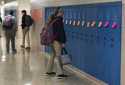 A JCTMS students arrives at her locker Monday morning to find a positive message left for her by a teacher (Photo by Toni Konz, WDRB News)