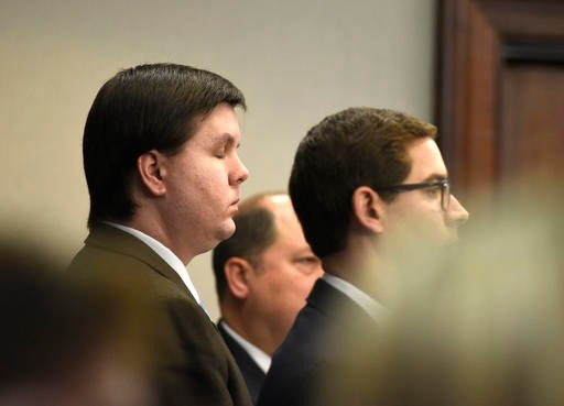 John Carrington/Atlanta Journal-Constitution via AP). Justin Ross Harris, left, stands with his defense as a jury enters the courtroom at the Glynn County Courthouse in Brunswick, Georgia.
