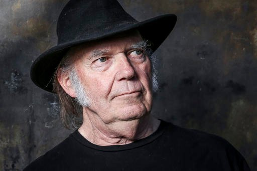 """Photo by Rich Fury/Invision/AP, File). FILE - In this May 18, 2016, file photo, Neil Young poses for a portrait in Calabasas, Calif., to promote his new album, """"Earth."""""""