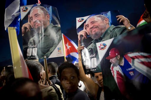 (AP Photo/Natacha Pisarenko). Participants hold portraits of Fidel Castro during a rally honoring the late Cuban leader at the Revolution Plaza in Havana, Cuba, Tuesday, Nov. 29, 2016.