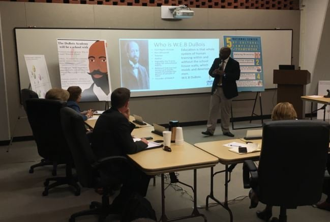 JCPS Chief Equity Officer John Marshall presents a plan regarding the proposed Males of Color Academy during a work session in August