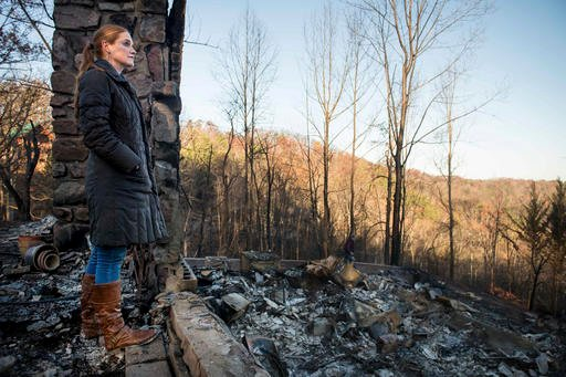 (Andrew Nelles/The Tennessean via AP). Veronica Carney looks at the skyline from the remains of the home she grew up in, Thursday, Dec. 1, 2016, in Gatlinburg, Tenn. Carney flew in from Massachusetts to assist her parents.