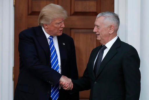 AP Photo/Carolyn Kaster, File). FILE - In this Nov. 19, 2016, file photo, President-elect Donald Trump shakes hands with retired Marine Corps Gen. James Mattis as he leaves Trump National Golf Club Bedminster clubhouse in Bedminster, N.J.