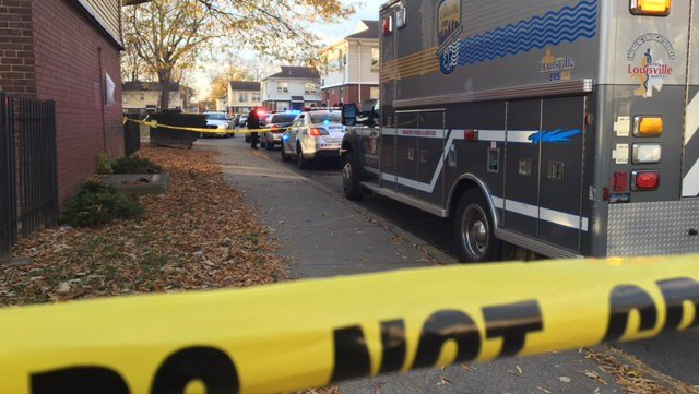 Police search for clues after a man was gunned down in the Russell neighborhood on Friday, Dec. 2.
