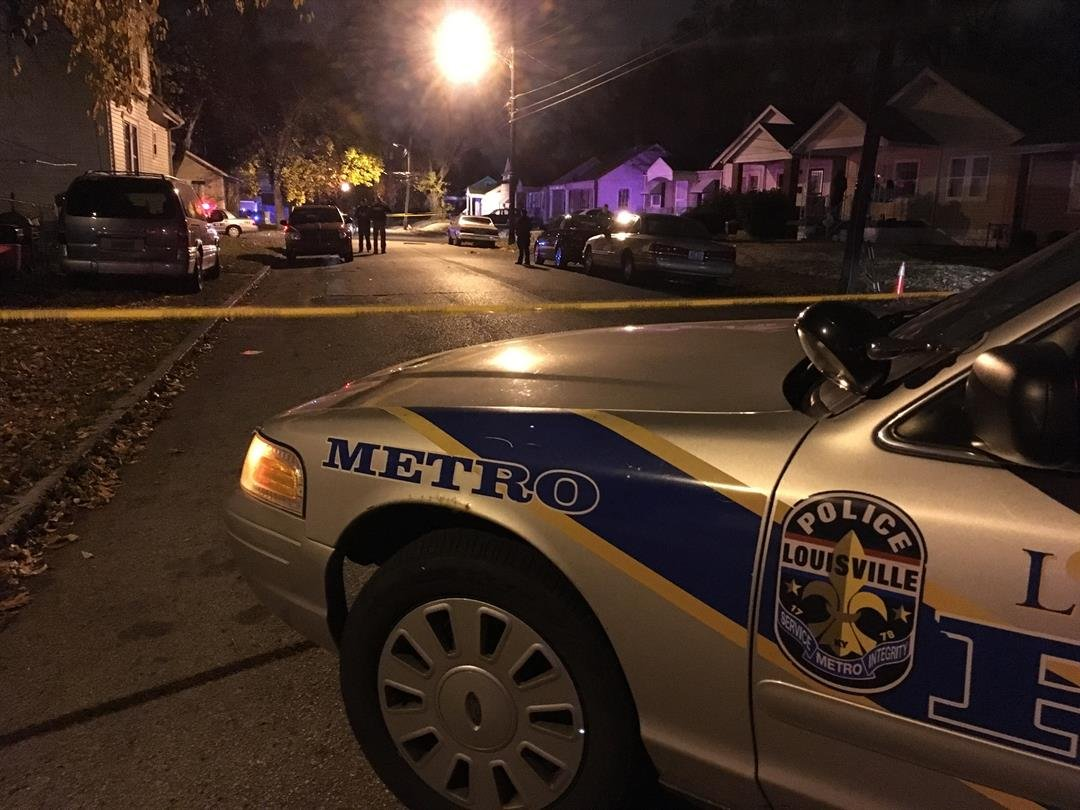 Homicide detectives on the scene of a fatal shooting in the Algonquin neighborhood on Dec. 3, 2016.
