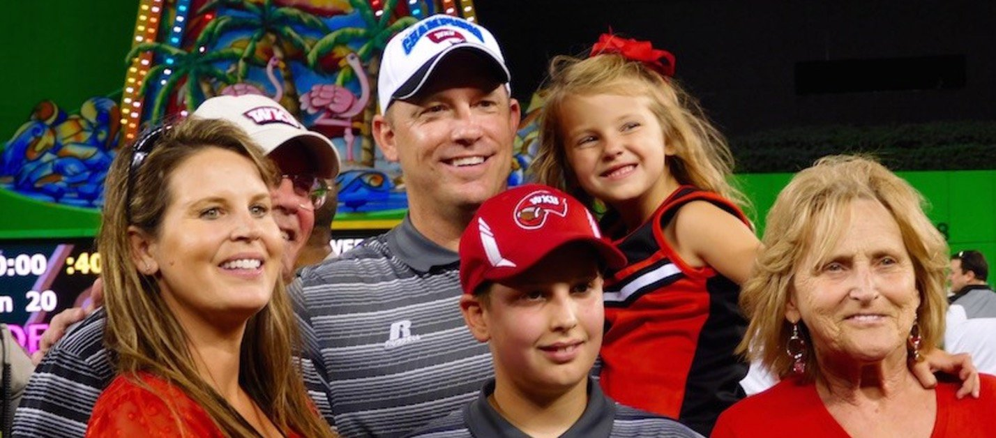 Jeff Brohm, with his family in this photo, believes he can build a Big Ten winner at Purdue.