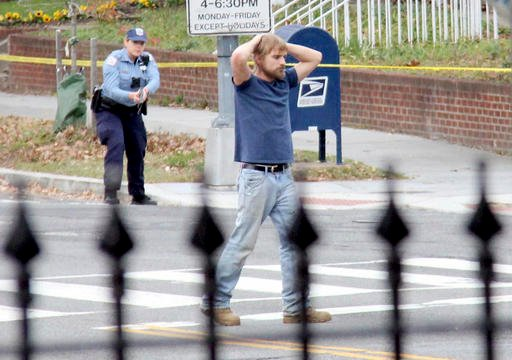 (Sathi Soma via AP). Edgar Maddison Welch, 28 of Salisbury, N.C., surrenders to police Sunday, Dec. 4, 2016, in Washington. Welch, who said he was investigating a conspiracy theory about Hillary Clinton running a child sex ring out of a pizza place.