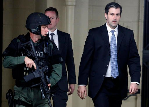 (AP Photo/Mic Smith, File). FILE- In this Monday, Dec. 5, 2016 file photo, Michael Slager, at right, walks from the Charleston County Courthouse under the protection from the Charleston County Sheriff's Department.