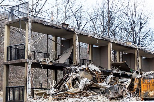 (AP Photo/Erik Schelzig). The balconies of a burned-out resort are seen in a heavily damaged neighborhood in Gatlinburg, Tenn., on Friday, Dec. 9, 2016. The resort town reopened to the public for the first time since wildfires on Nov. 28.