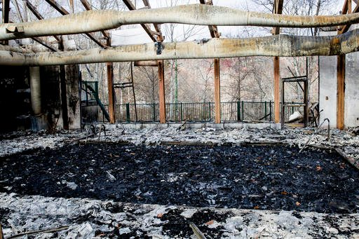 (AP Photo/Erik Schelzig). A pool is filled with ashes and debris at the Laurel Point Resort in Gatlinburg, Tenn., on Friday, Dec. 9, 2016. Gatlinburg reopened to the public for the first time since fatal wildfires spread to the city on Nov. 28.