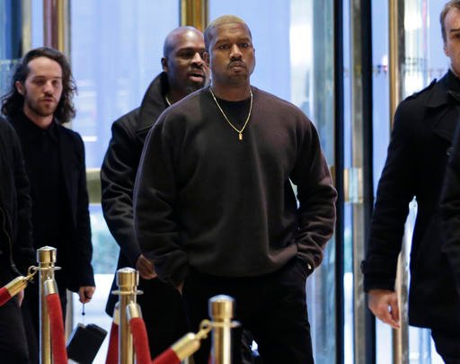 (AP Photo/Seth Wenig). Kanye West enters Trump Tower in New York, Tuesday, Dec. 13, 2016.