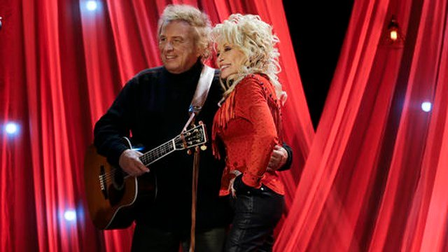 (AP Photo/Mark Humphrey). Dolly Parton poses with Don McLean during a taping for Dolly Parton's Smoky Mountain Rise Telethon Tuesday, Dec. 13, 2016, in Nashville, Tenn.