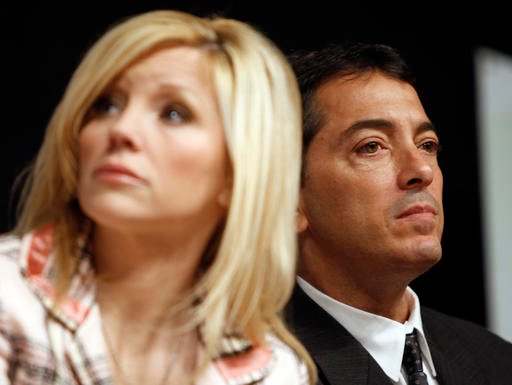 (AP Photo/Matt Sayles, File). FILE - In this Sept. 5, 2008, file photo, actor Scott Baio, right, and his wife, Renee, are seen during a news conference to kick off National Newborn Screening Awareness Month in Los Angeles.