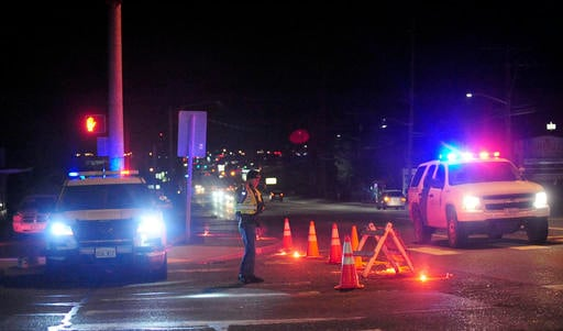 Brandy Shreve/Skagit Valley Herald via AP). A Washington State Trooper directs traffic around a roadblock near Skagit Valley College in Mount Vernon, Wash., Thursday, Dec. 15, 2015.