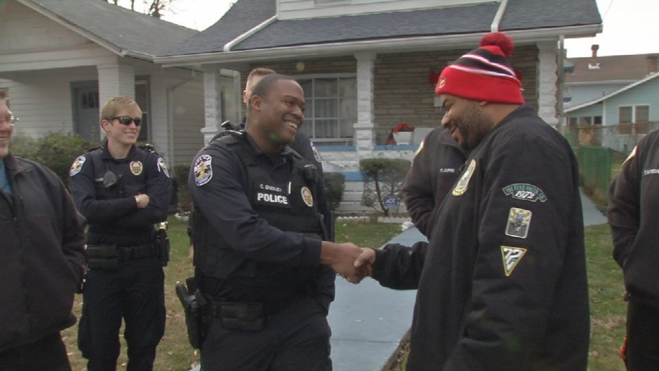 Phillip Neal Jr. was reunited with the first responders who helped saved his son's life. (Photo by Toni Konz, WDRB News)