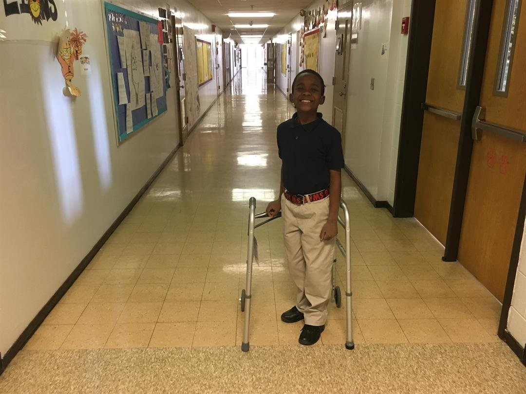 Phillip Neal III is no longer using a wheelchair, he now gets around with the help of a walker (Photo by Toni Konz, WDRB News)