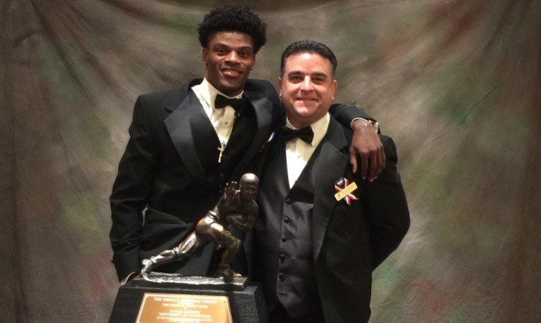 Lamar Jackson with Louisville football sports information director Rocco Gasparro before a post-Heisman event. (Photo via Louisville football Facebook)