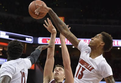 Ray Spalding blocks a shot during Saturday's win over Eastern Kentucky. (AP photo)