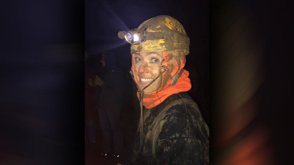 Sarah Blevins and six other cavers set out Saturday on a 12–15 hour cave survey, but heavy rain on the surface caused water in the cave to rise higher than expected.