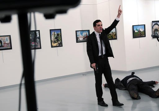 (AP Photo/Burhan Ozbilici). A man identified as Mevlut Mert Altintas shouts after shooting Andrei Karlov, the Russian Ambassador to Turkey, at a photo gallery in Ankara, Turkey, Monday, Dec. 19, 2016.