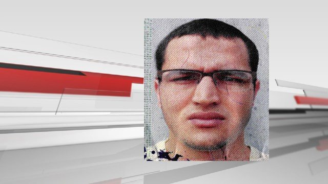(German police via AP). The photo issued by German federal police on Wednesday, Dec. 21, 2016 shows 24-year-old Tunisian Anis Amri on a photo that was used on the documents found in the truck.