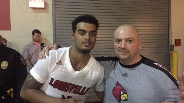 Quentin Snider celebrated Louisville's win over Kentucky with his father Wednesday night.