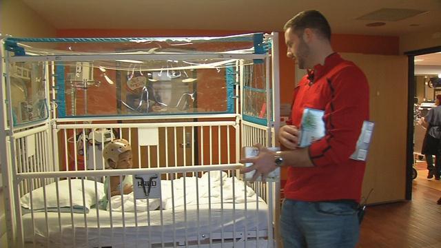 Former U of L basketball star Luke Hancock visited sick kids at Norton Children's Hospital on Thursday, Dec. 22, 2016.