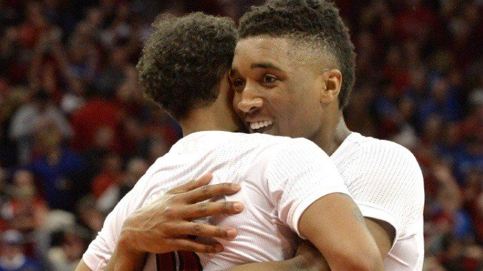 Louisville's Donovan Mitchell embraces Quentin Snider after the Cardinals beat Kentucky. (AP photo by Timothy Easley)