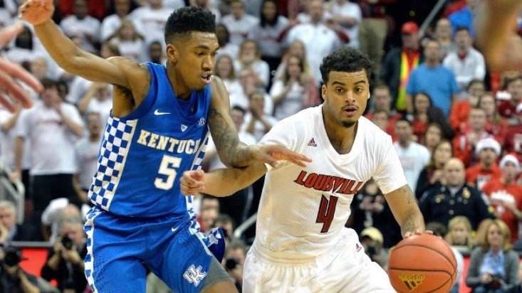 Louisville's Quentin Snider works against Malik Monk. (AP photo by Timothy Easley)