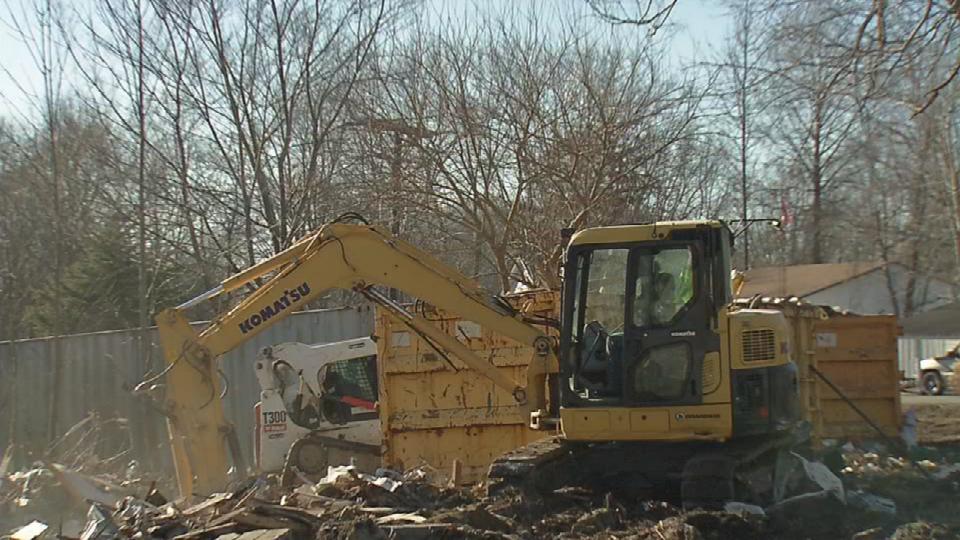 Demolition crews clean up demolished homes in Austin, Indiana.