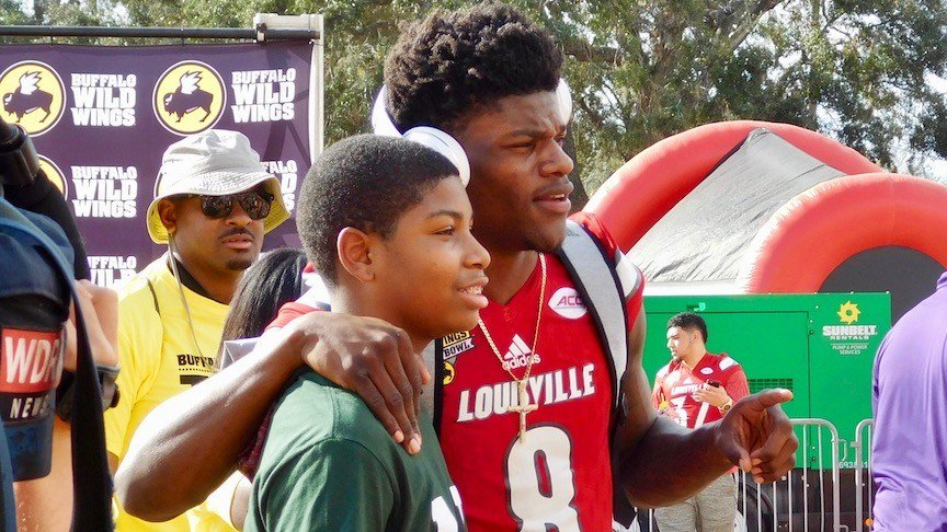 Lamar Jackson with a young fan in Orlando. (WDRB photo by Eric Crawford)