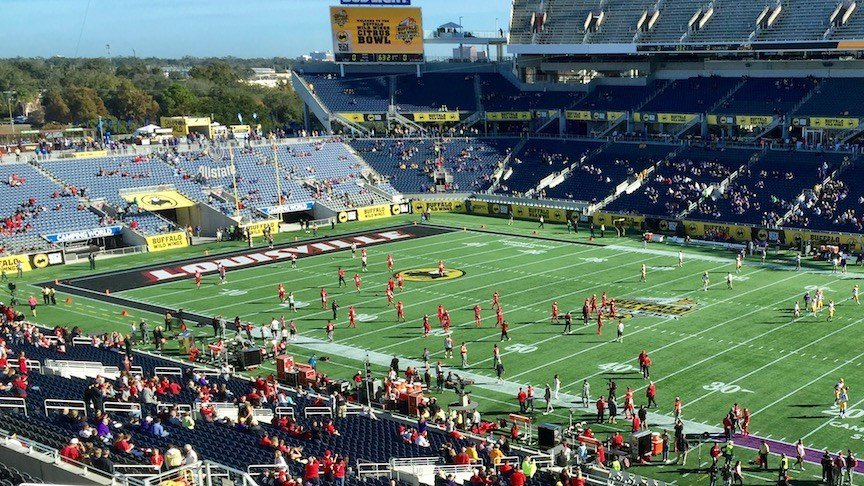 Louisville warms up before its Citrus Bowl matchup against LSU (WDRB photo by Eric Crawford)
