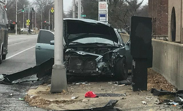 A Toyota Camry sits disabled at the corner of 7th and Muhammad Ali after it was hit by a stolen car.