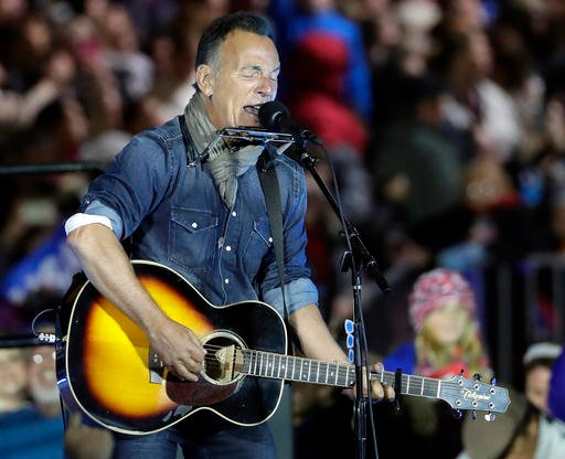 AP Photo/Matt Slocum, File). FILE - In this Nov. 7, 2016, file photo Bruce Springsteen performs during a Hillary Clinton campaign event at Independence Mall in Philadelphia.