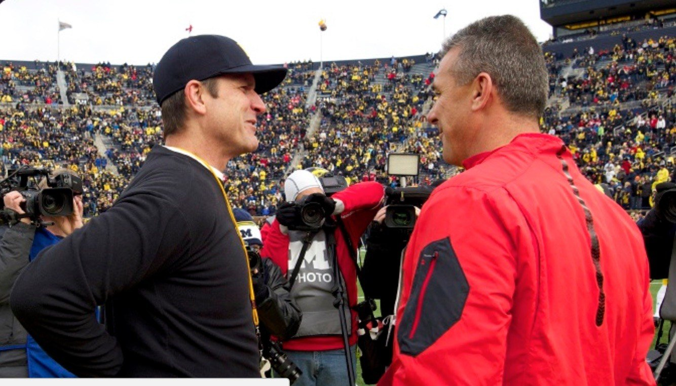 Michigan's Jim Harbaugh (left) and Urban Meyer of Ohio State weren't able to help the Big Ten with bowl wins this season.