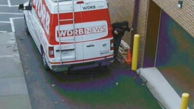 Michael Priest attempts to hide from police in WDRB's parking lot on Jan. 2, 2017,