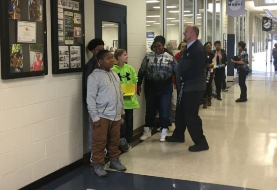 Moore principal Rob Fulk talks with students at the school on Friday, Jan. 6, 2017. (Photo by Toni Konz, WDRB News)