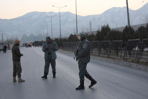 (AP Photo/Rahmat Gul). Afghan security forces stand guard near the site of two blasts in Kabul, Afghanistan, Tuesday, Jan. 10, 2017. Two loud explosions have rocked the Afghan capital of Kabul, causing casualties.