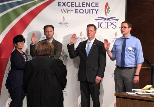 Ben Gies, Chris Brady and Chris Kolb are sworn in to the Jefferson County Board of Education on Tuesday, Jan. 10, 2017 (Photo by Toni Konz, WDRB News)