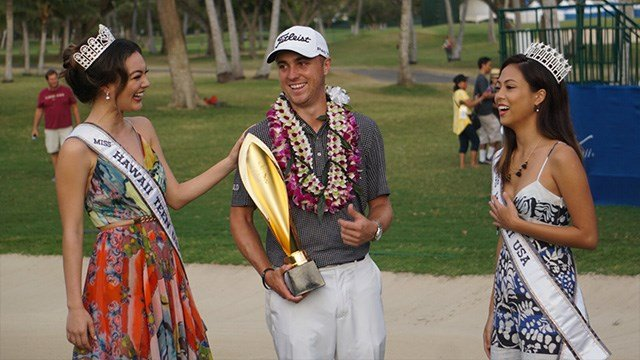 Justin Thomas accepts a second straight winner's trophy on the PGA Tour after Sunday's win in the Sony Open. (PGA Twitter photo)