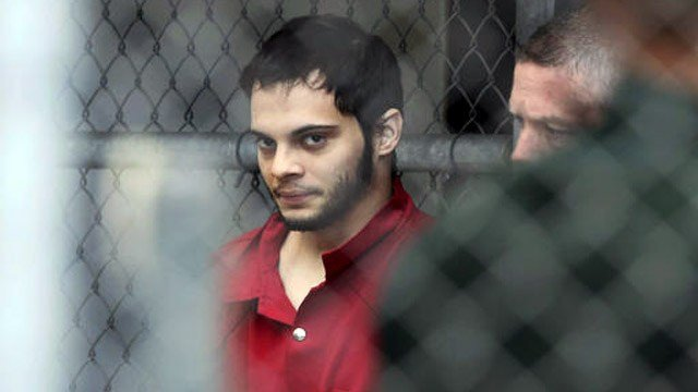 (Amy Beth Bennett/South Florida Sun-Sentinel via AP, File). FILE- In this Jan. 9, 2017, file photo, Esteban Santiago is taken from the Broward County main jail as he is transported to the federal courthouse in Fort Lauderdale, Fla.