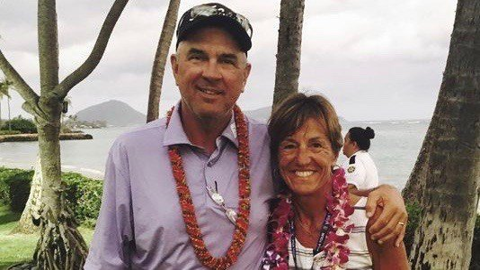 Mike and Jani Thomas of Goshen, Ky., pose outside the clubhouse at Wailalae Country Club in Honolulu, Sunday, after their son, Justin Thomas, set a 72-hole scoring record to win the Sony Open. (AP photo by Doug Ferguson)
