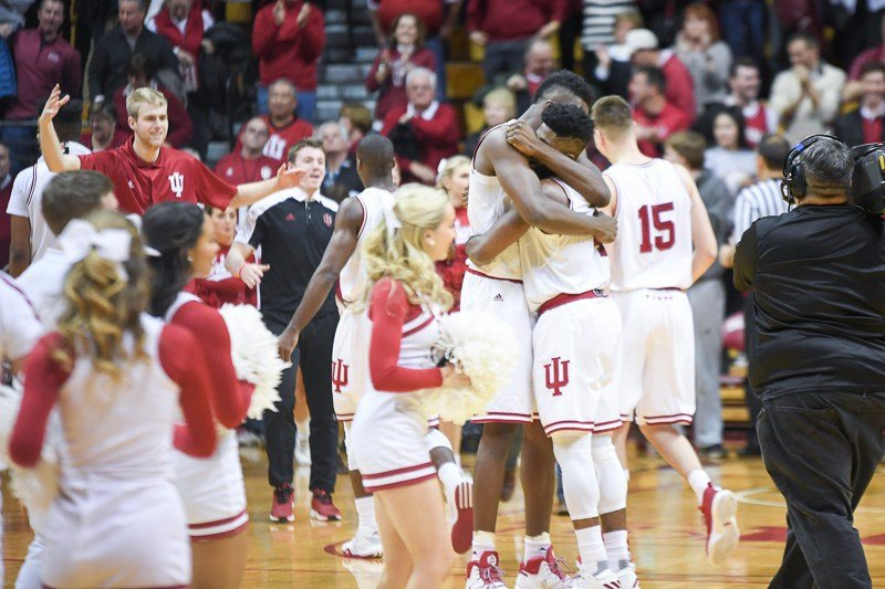 Thomas Bryant and Robert Johnson embrace after Indiana beat Penn State in triple overtime. (Jamie Owens photo.)
