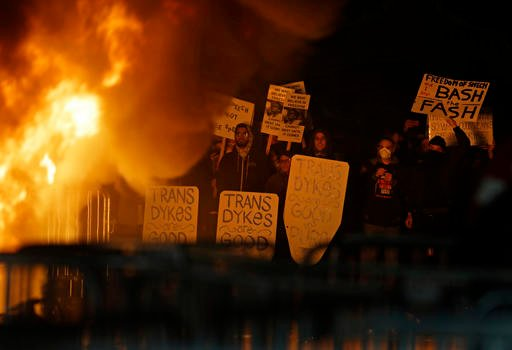 (AP Photo/Ben Margot). Protestors watch a bonefire on Sproul Plaza during a rally against the scheduled speaking appearance by Breitbart News editor Milo Yiannopoulos on the University of California at Berkeley campus on Wednesday, Feb. 1, 2017,