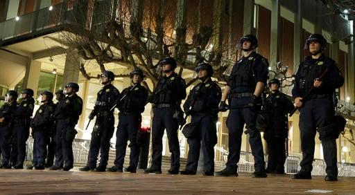 (AP Photo/Ben Margot). University of California at Berkeley police guard the building where Breitbart News editor Milo Yiannopoulos was to speak Wednesday, Feb. 1, 2017, in Berkeley, Calif.