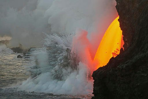 (U.S. Geological Survey via AP). This Jan. 29, 2017 photo provided by the U.S. Geological Survey shows a lava stream pouring out of a tube on the sea cliff at the Kamokuna ocean entry at the Hawaii Volcanoes National Park on the Big Island of Hawaii.