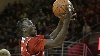 Deng Adel goes up for two of his team-best 19 points in Louisville's 70-67 win at Boston College on Saturday. (AP photo)