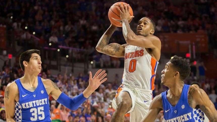 Florida guard Kasey Hill (0) drives to the basket between Kentucky forward Derek Willis (AP photo)