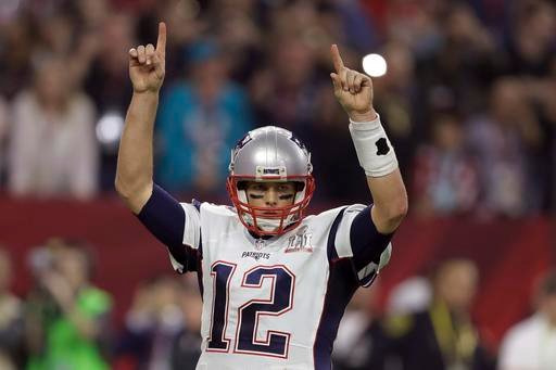 (AP Photo/Darron Cummings). New England Patriots' Tom Brady raises his arms after a touchdown, during the second half of the NFL Super Bowl 51 football game against the Atlanta Falcons, Sunday, Feb. 5, 2017, in Houston.