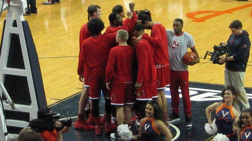 Louisville's lineup was sparse with four players missing at Virginia Monday night. (WDRB photo by Eric Crawford)